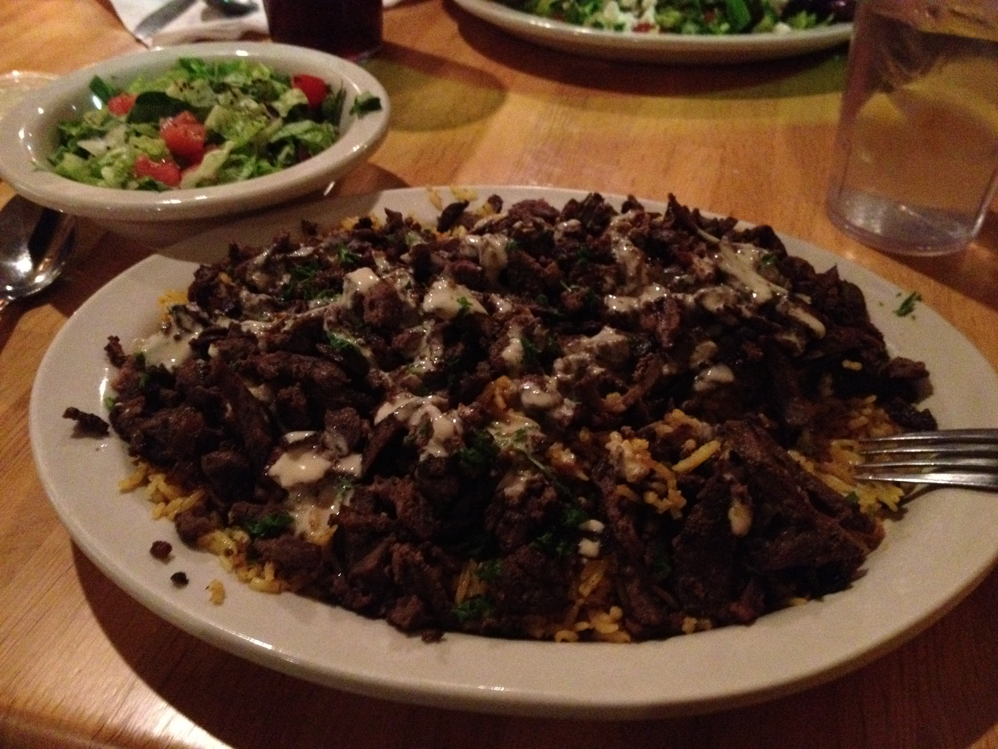 Lamb Shawerma over rice with a side salad