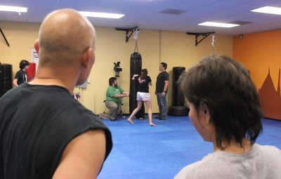 My Muay Thai teachers Arjun Dan King and Arjun Ying King watch shot setup - photo by Terrence Newber